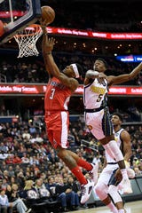 Washington Wizards guard Bradley Beal (3) goes to the basket past Indiana Pacers guard Edmond Sumner (5).