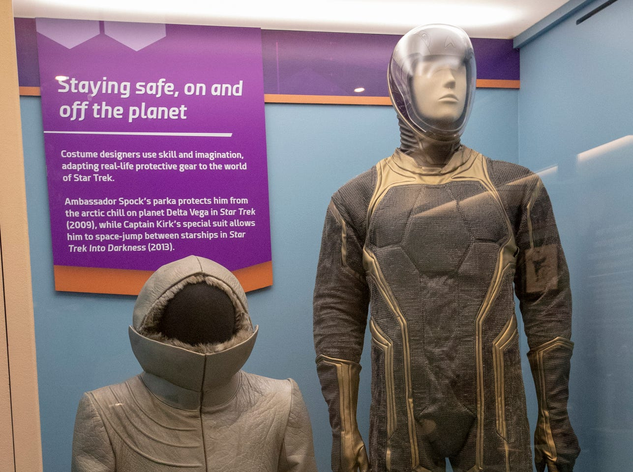 """Cold-weather gear and a spacesuit from the Star Trek universe are seen at The Children's Museum of Indianapolis, Wednesday, Jan. 23, 2019. The """"Star Trek: Exploring New Worlds"""" exhibit is made up of set pieces, ship models and outfits used during various Star Trek shows and movies and is on display at the museum from Feb. 2 through April 7, 2019."""