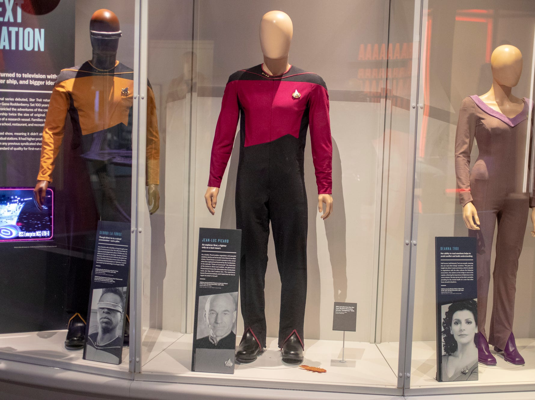 """Uniforms worn by prominent """"Star Trek: The Next Generation"""" characters are seen at The Children's Museum of Indianapolis, Wednesday, Jan. 23, 2019. The """"Star Trek: Exploring New Worlds"""" exhibit is made up of set pieces, ship models and outfits used during various Star Trek shows and movies and is on display at the museum from Feb. 2 through April 7, 2019."""
