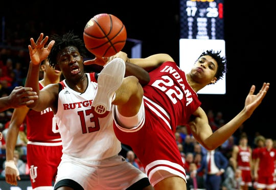 Rutgers Scarlet Knights forward Shaq Carter (13) battles Indiana Hoosiers forward Clifton Moore (22) for the ball during the first half at Rutgers Athletic Center (RAC).