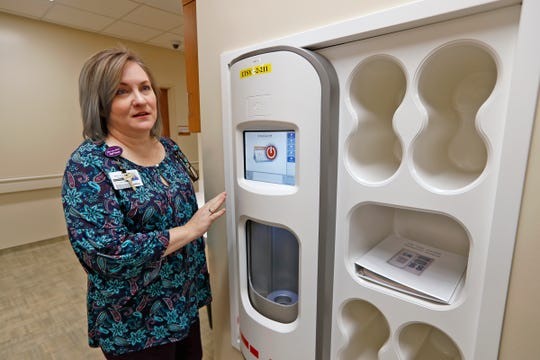 Marti Rowan, Communications Manager at Community Hospital East, shows a new pneumatic tube system found in the newly-renovated hospital units, Thursday, Jan. 31, 2019.  The hospital has undergone a $1.75 million makeover that is five years in the coming.