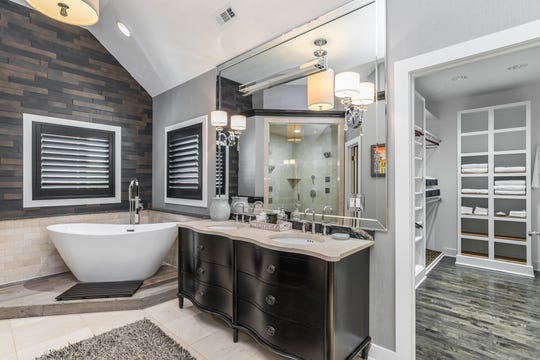 The master bathroom includes a steam shower and freestanding tub.