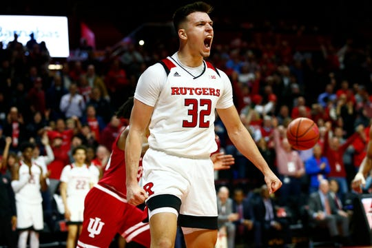 Rutgers Scarlet Knights guard Peter Kiss (32) reacts after a dunk against Indiana Hoosiers forward Damezi Anderson (23).