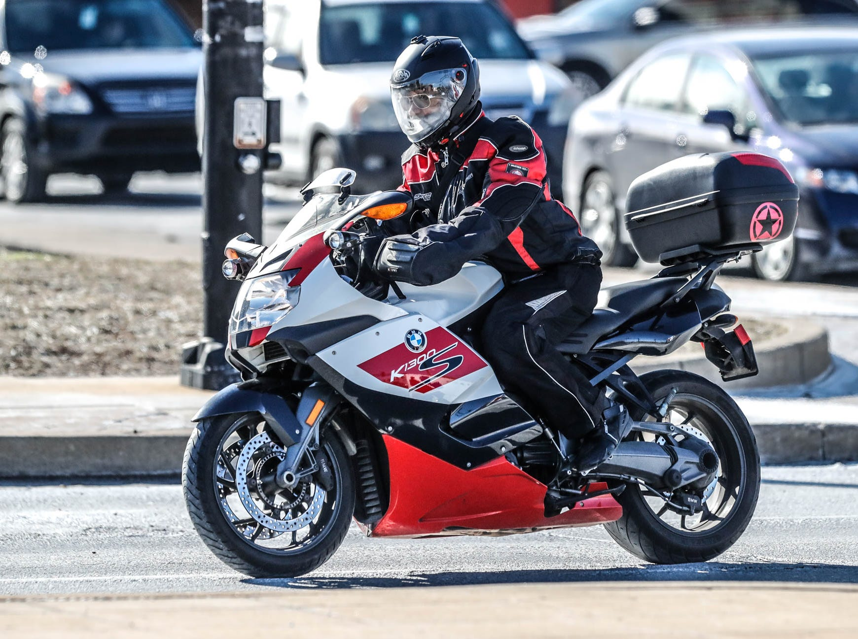 An adventurous motorcycle rider takes a spin on his bike near the intersection of Illinois Street and 38th St. in near sub-zero temperatures on Thursday, Jan. 31, 2019.