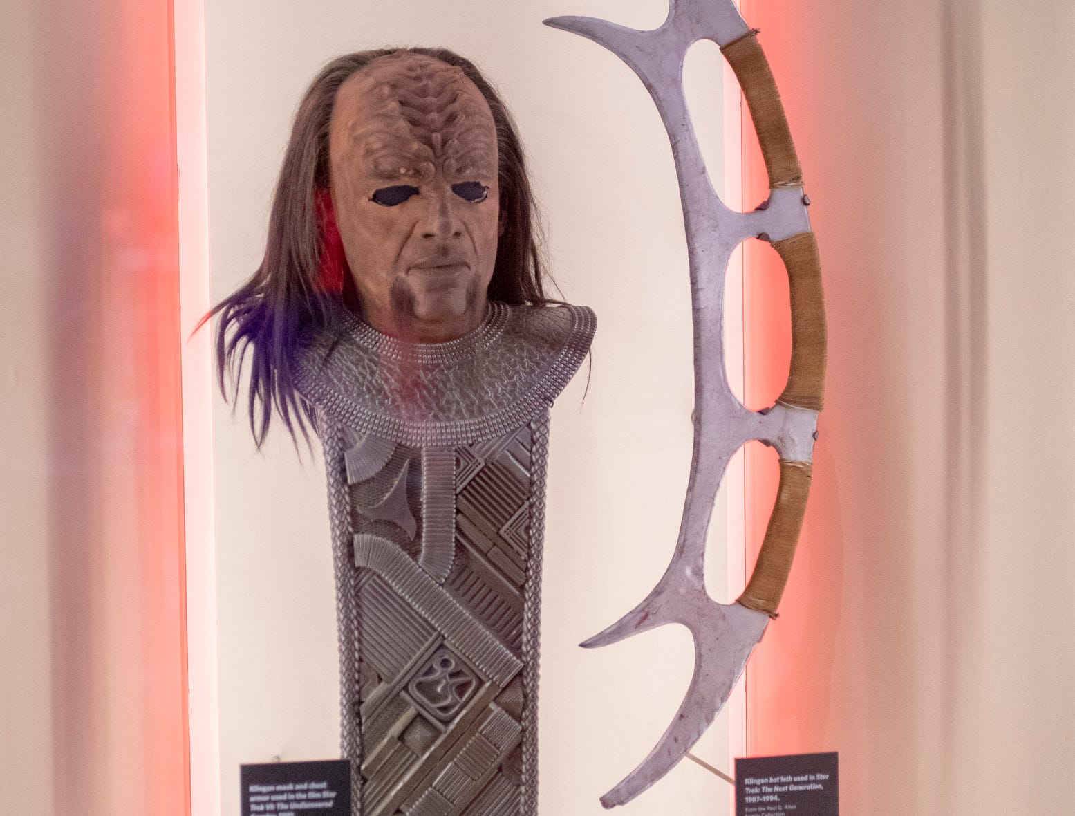 """A weapon called a bat'leth (right) and other Klingon paraphernalia are seen at The Children's Museum of Indianapolis, Indianapolis, Wednesday, Jan. 23, 2019. The """"Star Trek: Exploring New Worlds"""" exhibit is made up of set pieces, ship models and outfits used during various Star Trek shows and movies and is on display at the museum from Feb. 2 through April 7, 2019."""