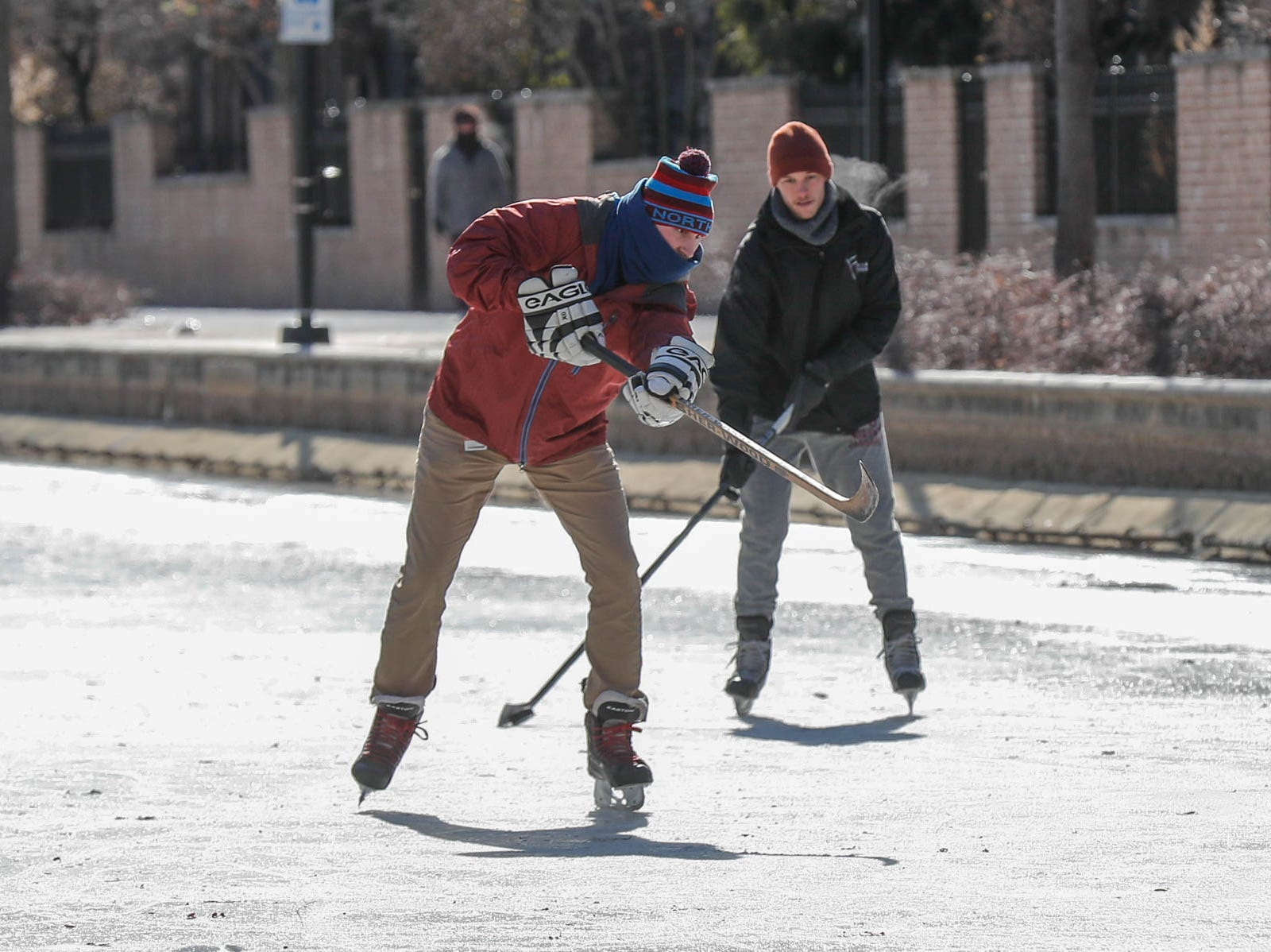 left to right, friends Jackson Richey, Charlie Hornett and Chase Fairchild, not shown here, get some free ice time to practice hockey skills on the downtown Indianapolis canal on Thursday, Jan. 31, 2019.