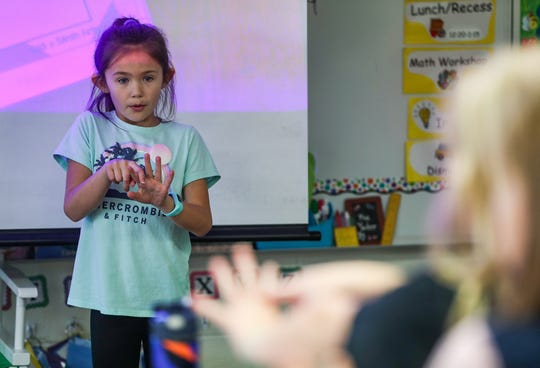 Paislee Tuell, a student in Becky Yoder's second-grade class, leads a breathing exercise at Hinkle Creek Elementary in Noblesville, Ind., Friday, Jan. 18, 2019.