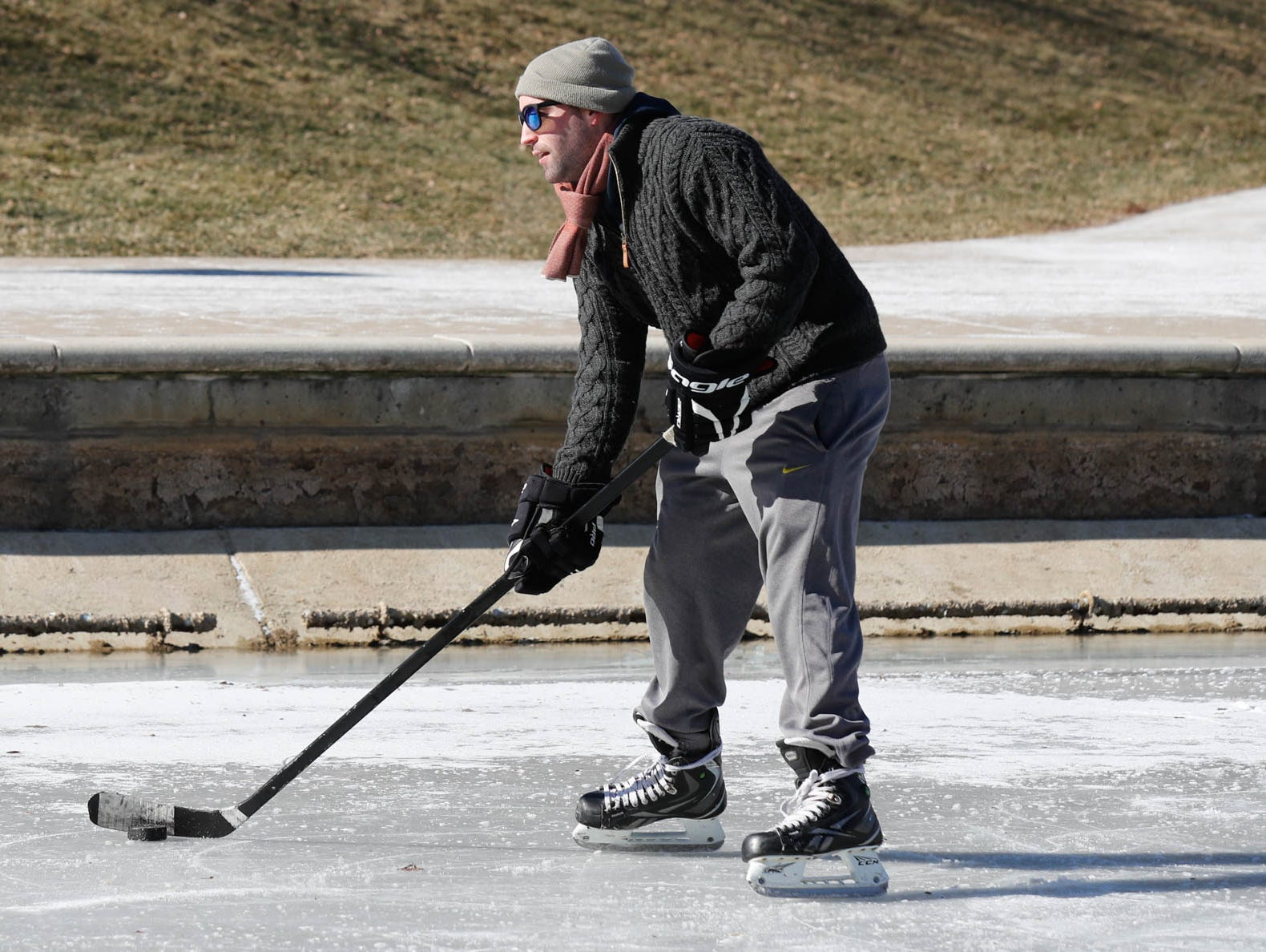Chase Fairchild, shown here, and friends friends Jackson Richey, and Charlie Hornett get some free ice time to practice hockey skills on the downtown Indianapolis canal on Thursday, Jan. 31, 2019.