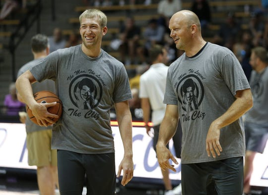 Robbie Hummel has a laugh with Brian Cardinal before the start of the Purdue Alumni basketball game Saturday, August 4, 2018, at Mackey Arena. The Black team defeated the Gold 101-91.