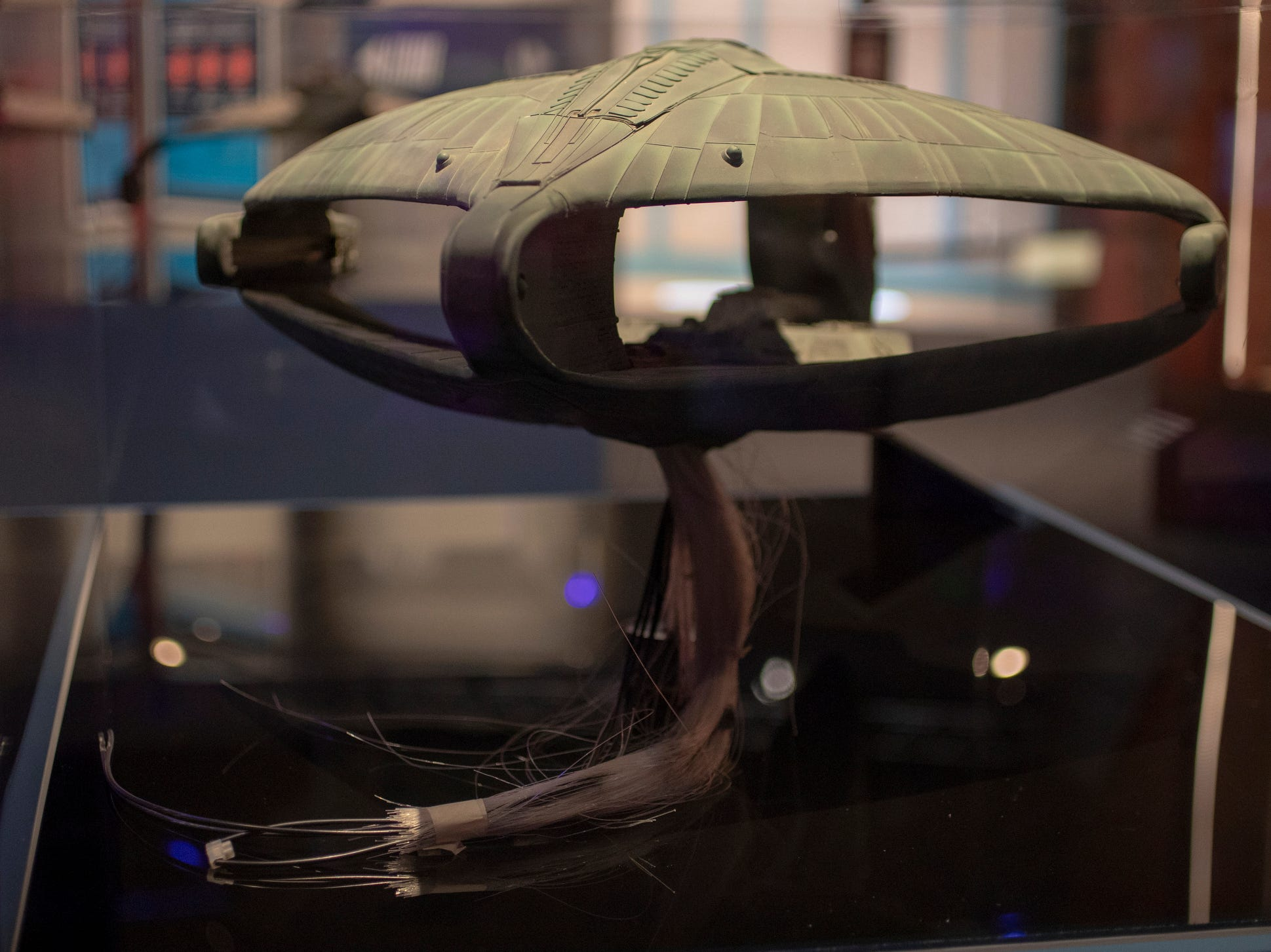 """A model of a Romulan D'deridex-class warbird from """"Star Trek: The Next Generation"""" is seen at The Children's Museum of Indianapolis, Wednesday, Jan. 23, 2019. The """"Star Trek: Exploring New Worlds"""" exhibit is made up of set pieces, ship models and outfits used during various Star Trek shows and movies and is on display at the museum from Feb. 2 through April 7, 2019."""
