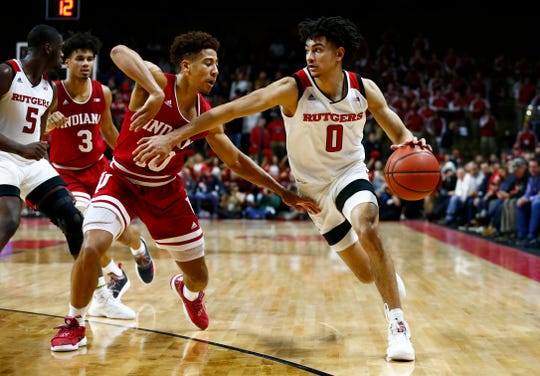 Rutgers Scarlet Knights guard Geo Baker (0) dribbles the ball as Indiana Hoosiers guard Rob Phinisee (10) defends.