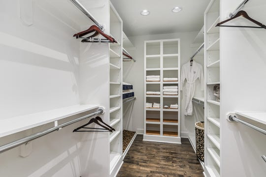 A walk-in closet is part of the master suite, complete with provided robes.