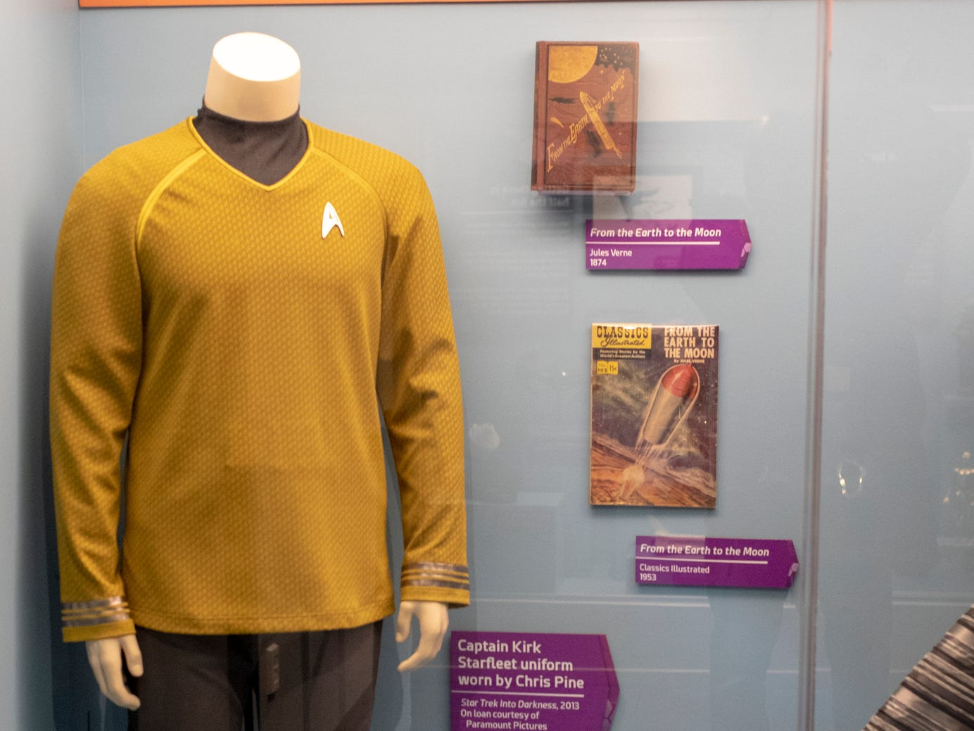 """A Captain Kirk Starfleet uniform worn by actor Chris Pine in the more recent Star Trek films is seen at The Children's Museum of Indianapolis, Wednesday, Jan. 23, 2019. The """"Star Trek: Exploring New Worlds"""" exhibit is made up of set pieces, ship models and outfits used during various Star Trek shows and movies and is on display at the museum from Feb. 2 through April 7, 2019."""