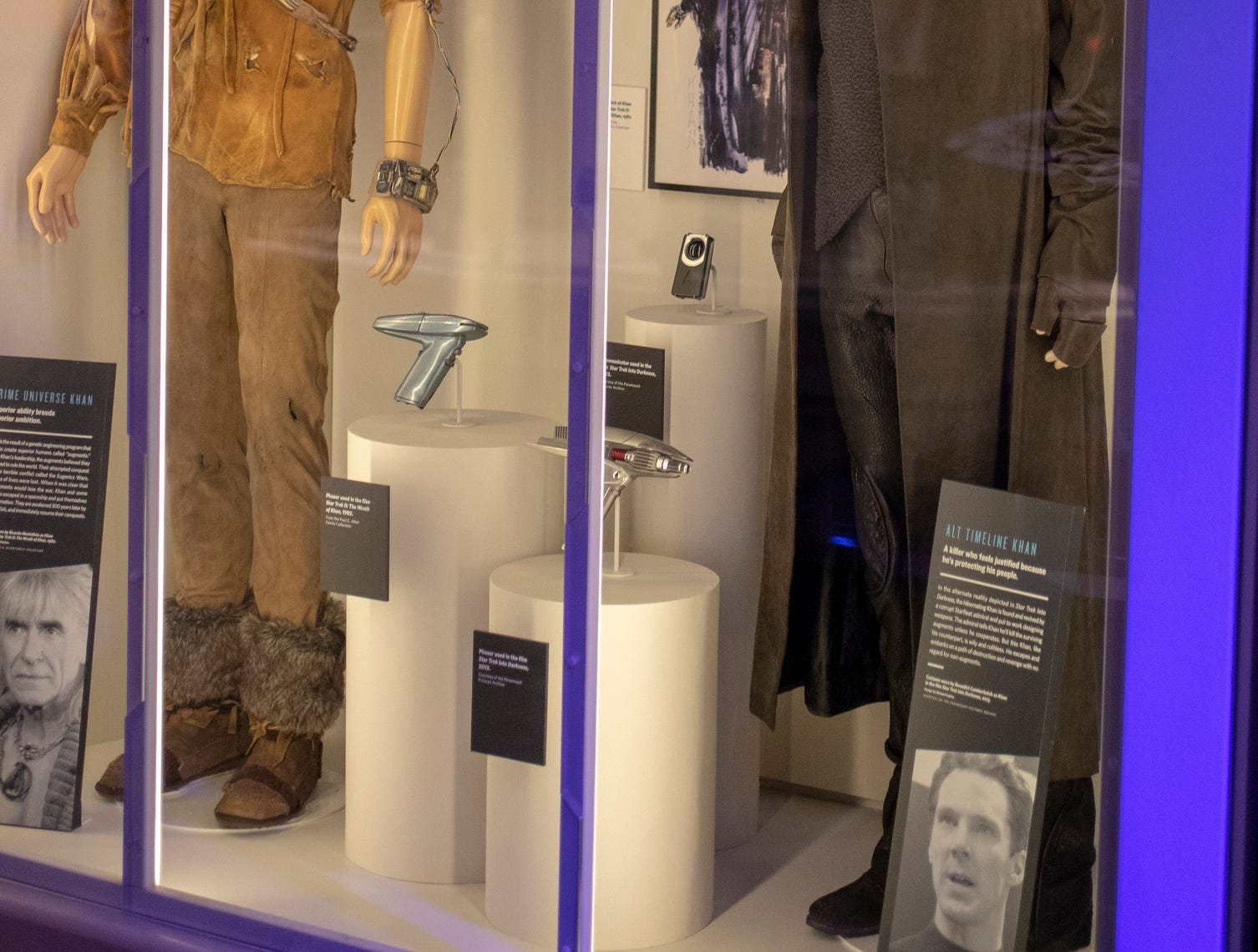 """Outfits worn by the notorious character Khan in """"Star Trek II: The Wrath of Khan"""" (left) and """"Star Trek Into Darkness"""" are seen at The Children's Museum of Indianapolis, Wednesday, Jan. 23, 2019. The """"Star Trek: Exploring New Worlds"""" exhibit is made up of set pieces, ship models and outfits used during various Star Trek shows and movies and is on display at the museum from Feb. 2 through April 7, 2019."""