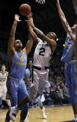Butler Bulldogs guard Aaron Thompson (2) is fouled by Marquette Golden Eagles forward Theo John (4).
