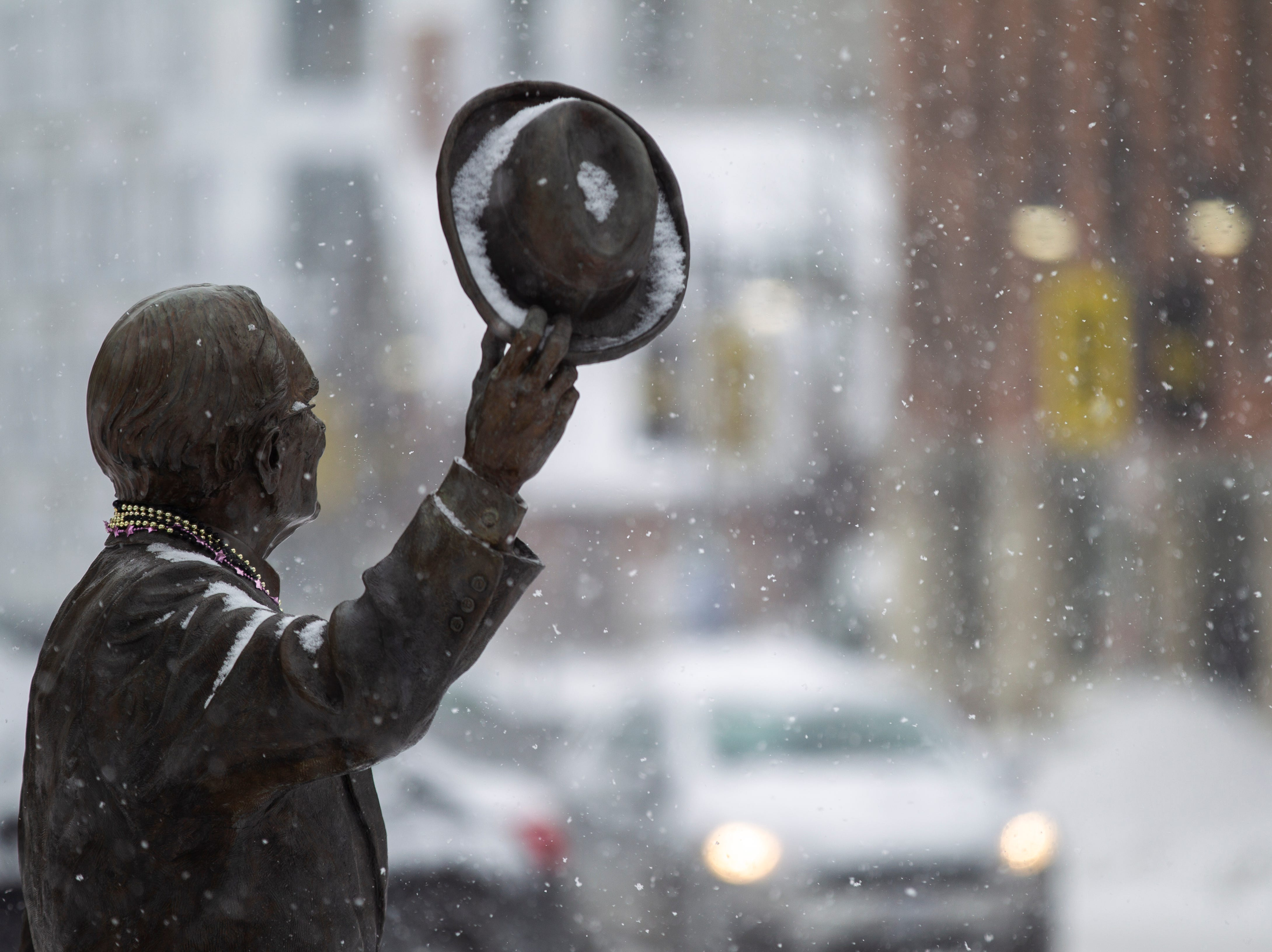 A statue of Irving B. Weber gets covered in snow on Thursday, Jan. 31, 2019, in downtown Iowa City, Iowa.