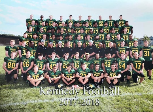 Gerald Belz, bottom row third from left, died on Jan. 30 after exposure to extreme weather on the University of Iowa campus. His fellow teammates remember him as quiet, but fiercely encouraging.