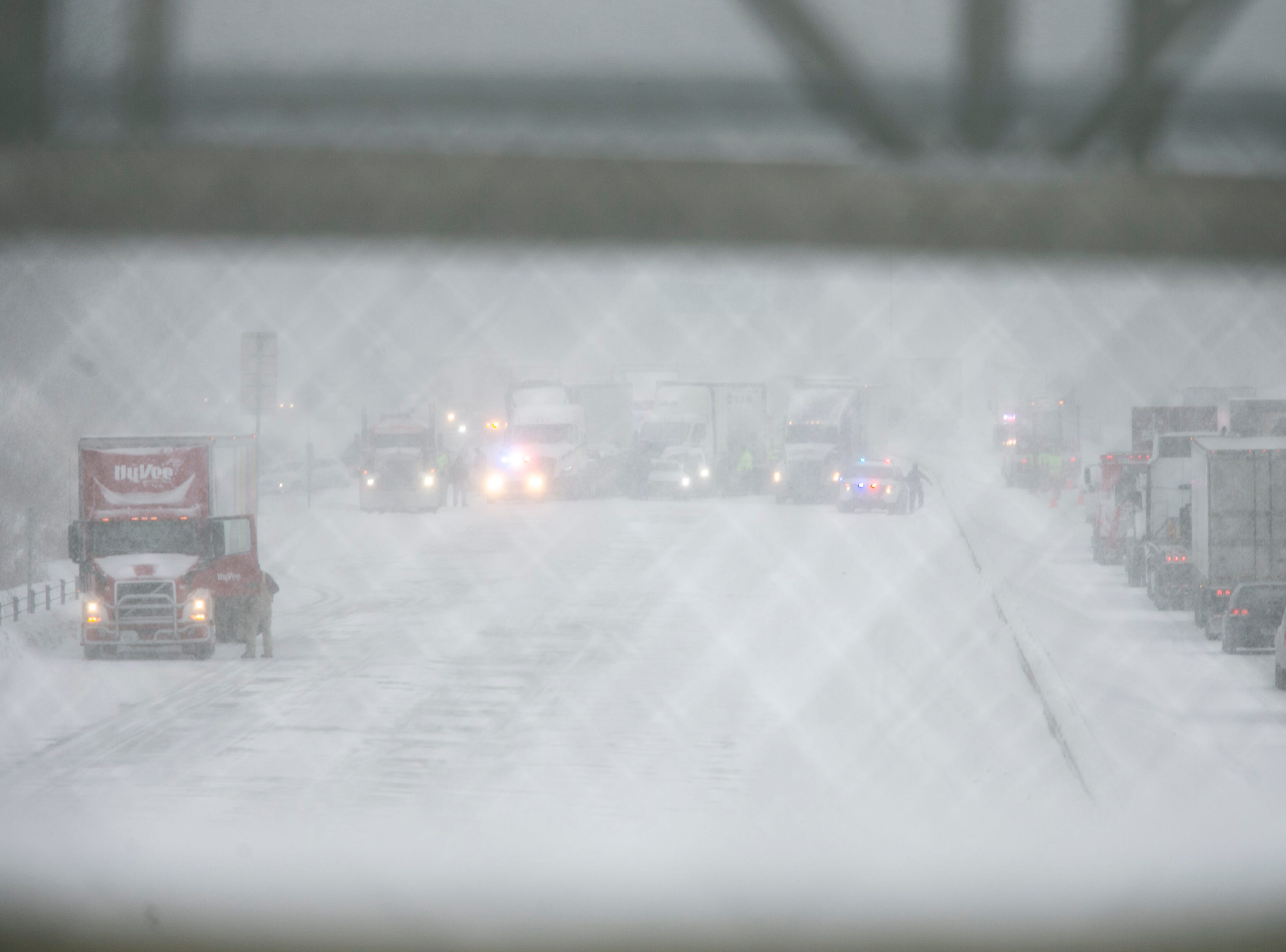 Traffic gets backed up in westbound lanes as snow falls on Thursday, Jan. 31, 2019, along Interstate 80 between exits 242 at 1st Avenue and exit 240 for IA 965 in Coralville, Iowa.