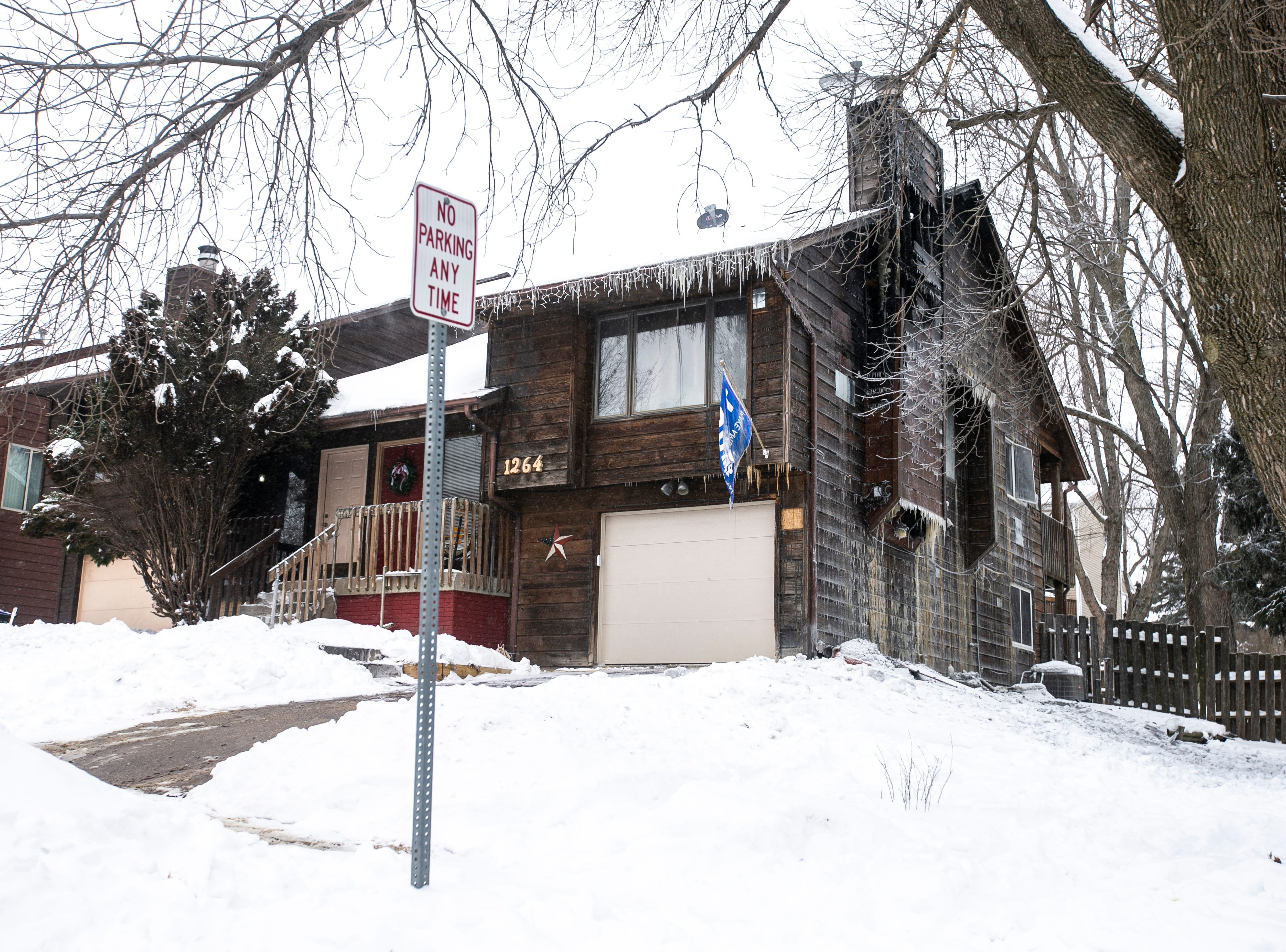 Icicles and debris are seen at 1264-6 Dolen Place after a fire Thursday, Jan. 31, 2019, on the southwest side of in Iowa City, Iowa.