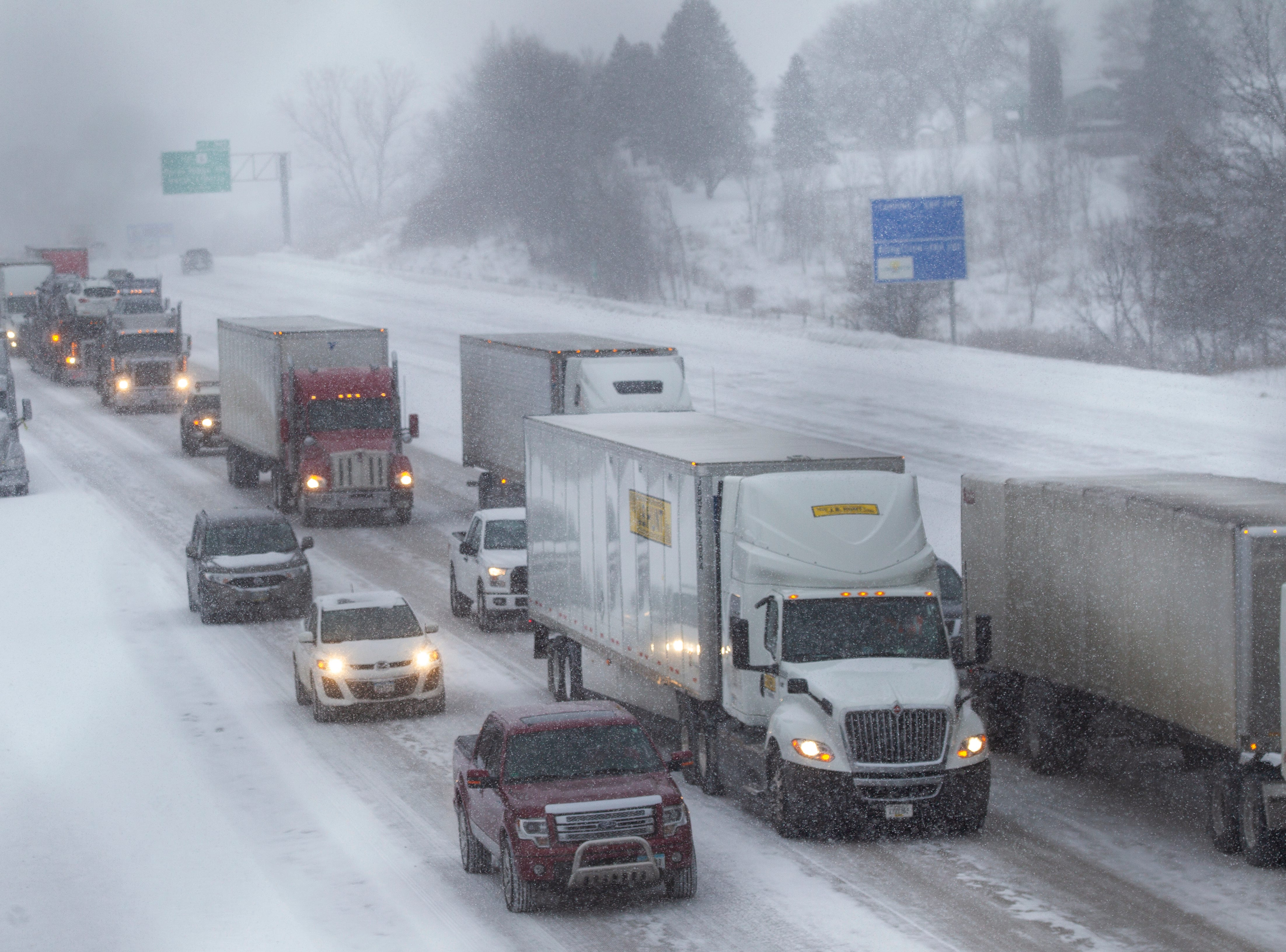 Traffic gets backed eastbound up as snow falls on Thursday, Jan. 31, 2019, along Interstate 80 between exits 242 at 1st Avenue and exit 240 for IA 965 in Coralville, Iowa.