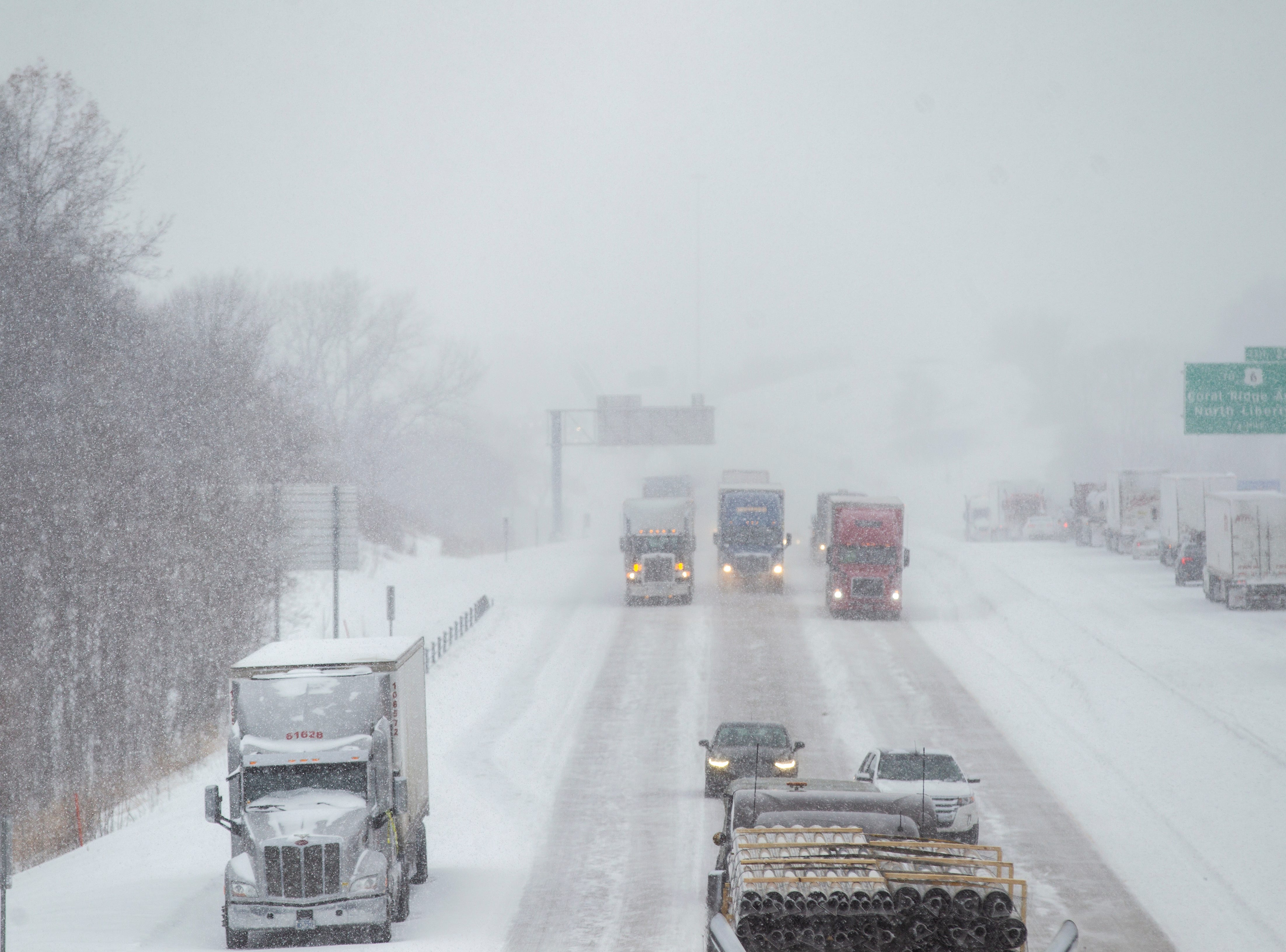 Traffic slows down in eastbound lanes as snow falls on Thursday, Jan. 31, 2019, along Interstate 80 between exits 242 at 1st Avenue and exit 240 for IA 965 in Coralville, Iowa.