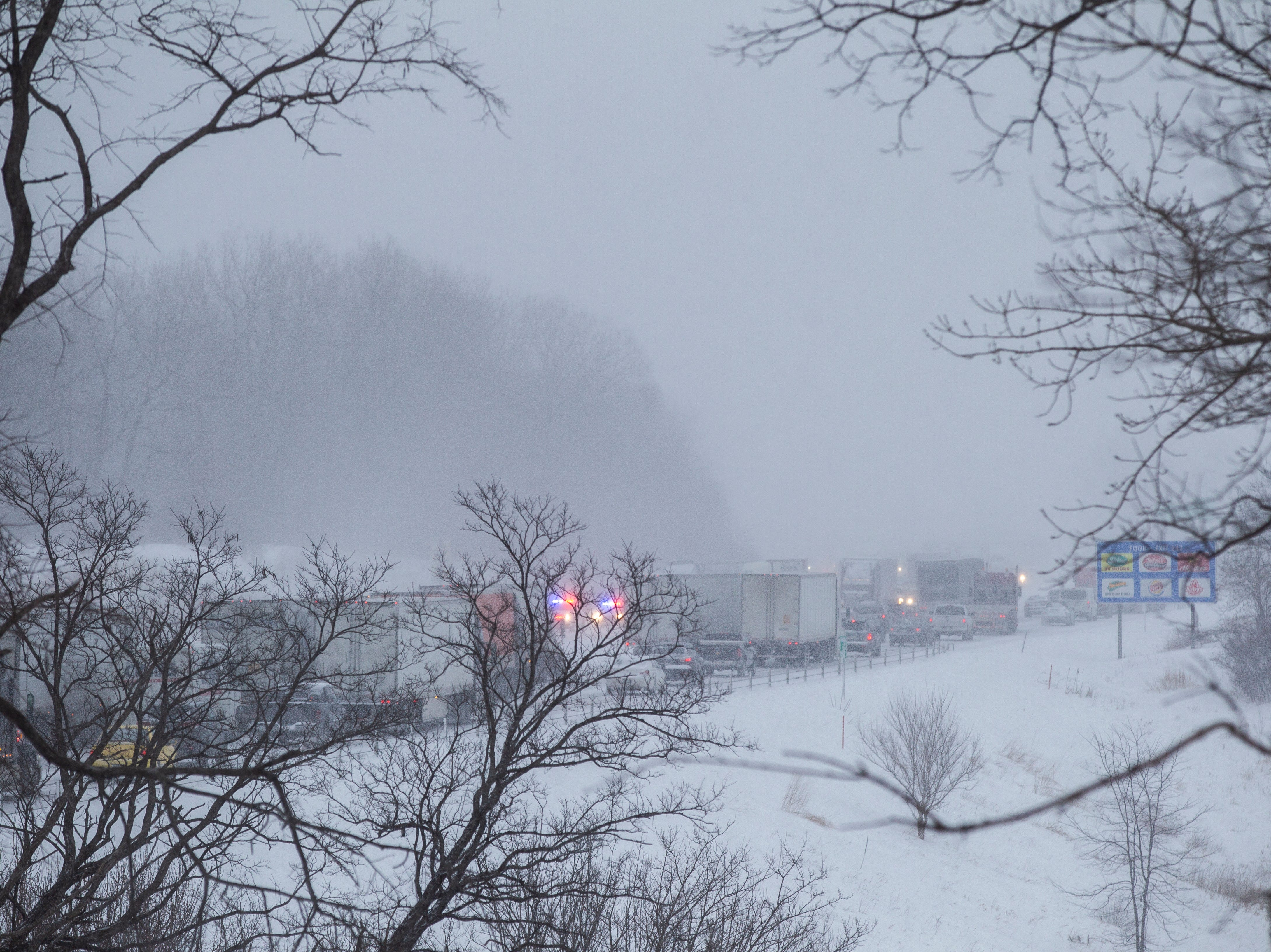 Traffic gets backed up in eastbound lanes as snow falls on Thursday, Jan. 31, 2019, along Interstate 80 between exits 242 at 1st Avenue and exit 240 for IA 965 in Coralville, Iowa.