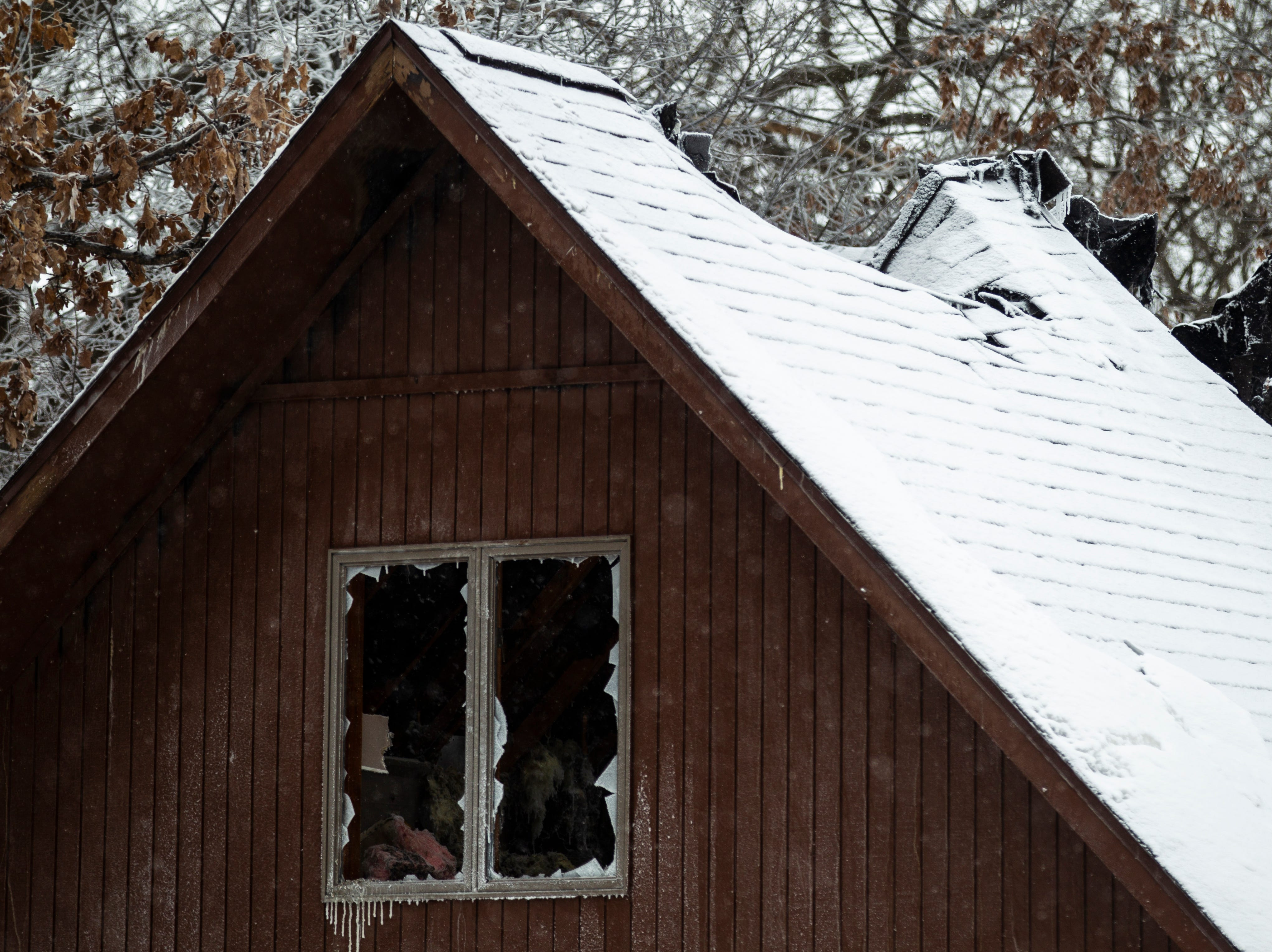 A partial roof collapse is seen after a fire Thursday, Jan. 31, 2019, at 1417 Eastview Drive in Coralville, Iowa.