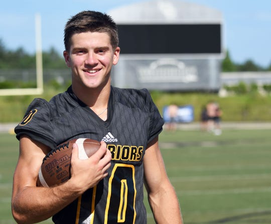 John Rhys Plumlee poses for a picture before his senior season at Oak Grove. Plumlee led the Warriors to a berth in the 6A title game at the end of the season, and two days before National Signing Day, he committed to Ole Miss.