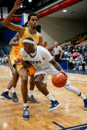Chris Howell attempts to drive past a Southern defender during Jackson State's game against the Jaguars on January 14, 2019 at the Lee. E. Williams Athletic and Assembly Center.