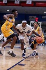 Chris Howell dribbles between two Southern defenders during Jackson State's game against the Jaguars on January 14, 2019, at the Lee E. Williams Athletic and Assembly Center