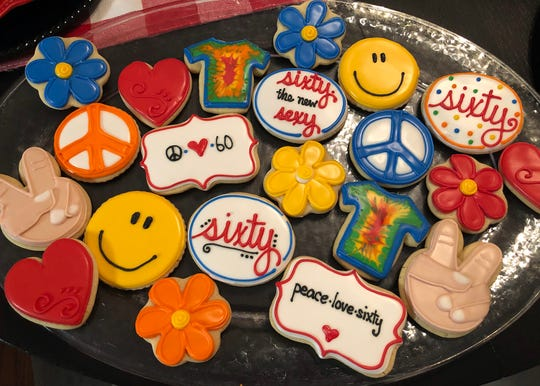 These cookies for a 60th birthday party are flooded with royal icing with added detail. Sugarbakers carries a selection of  cutters perfect for cookie baking.