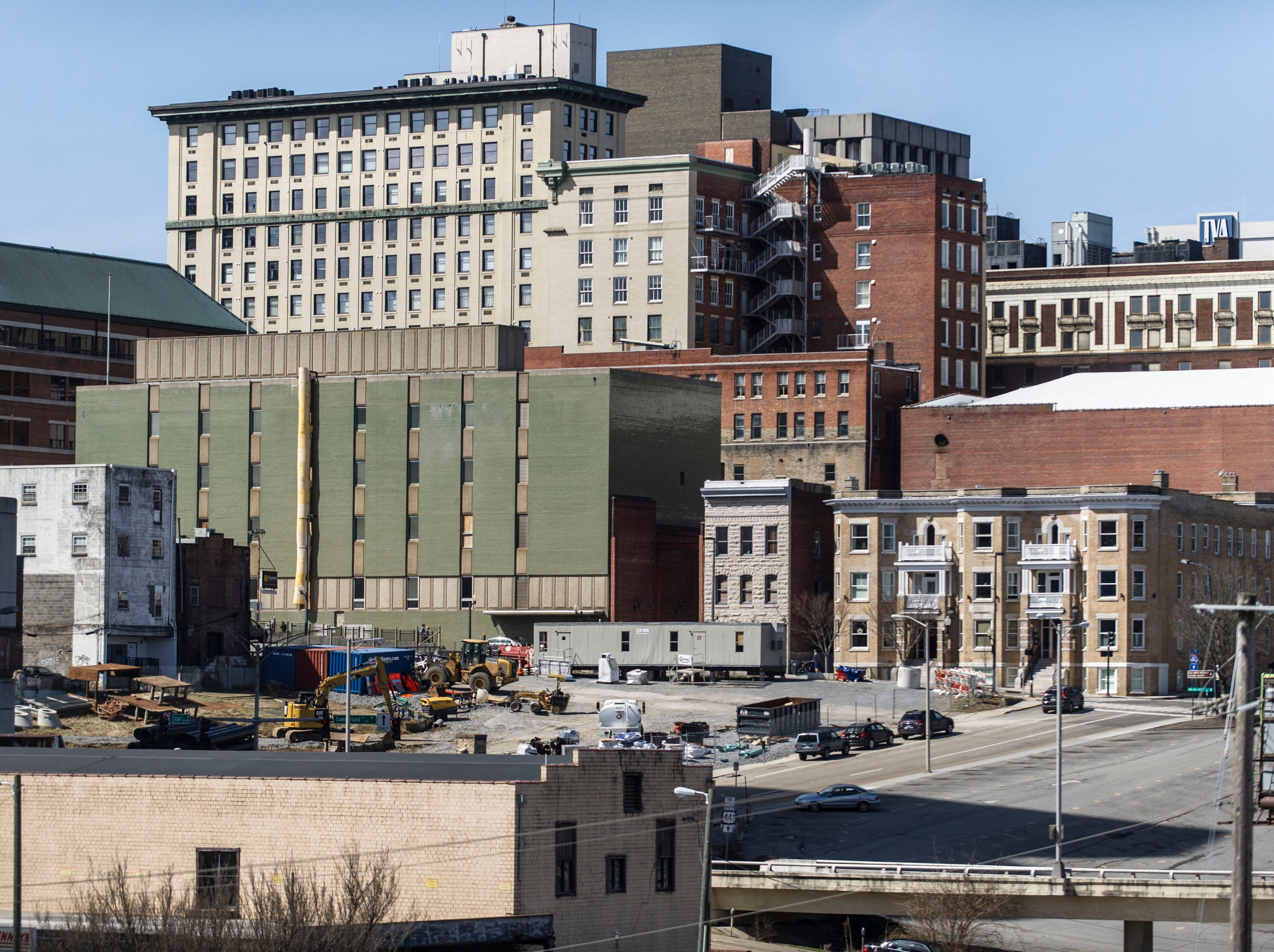 A portion of the downtown skyline is pictured March 8, 2015. Among the buildings are the Elliot condominiums, the former KUB headquarters, the Tennessee Theatre, and the Holston condominiums. The large vacant lot is the former News Sentinel building site.