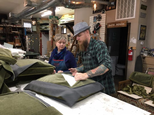 Wes Breitenbach stuffs a sofa cushion destined for Blackberry Mountain, the newest resort in the Blackberry Farms family.