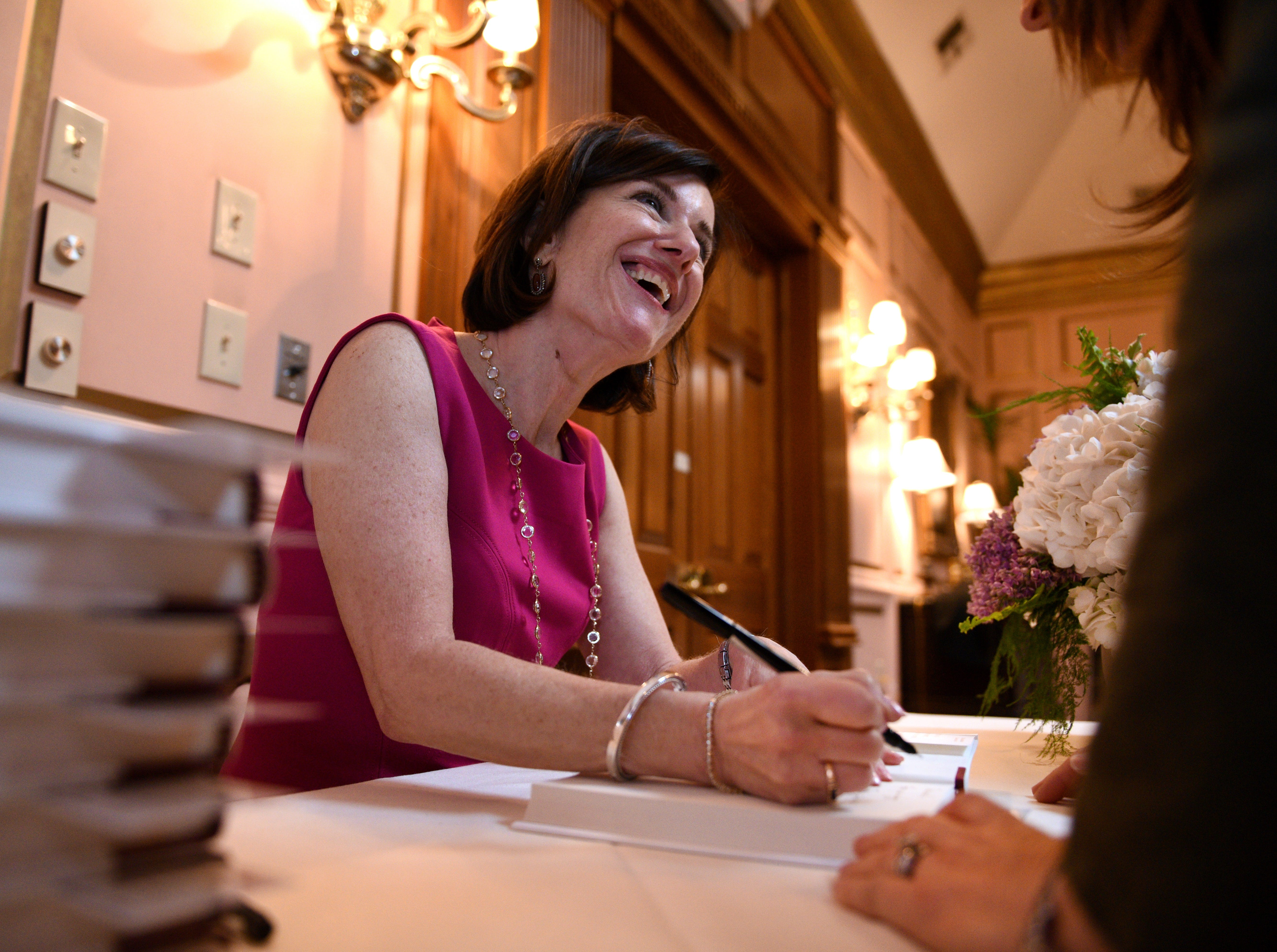 """Susan Packard, co-founder and former COO of HGTV, signing books at the launch of her new book """"New Rules of the Game: 10 Strategies for Women in the Workplace"""" during a luncheon at the Orangery Monday, Feb. 16, 2015."""
