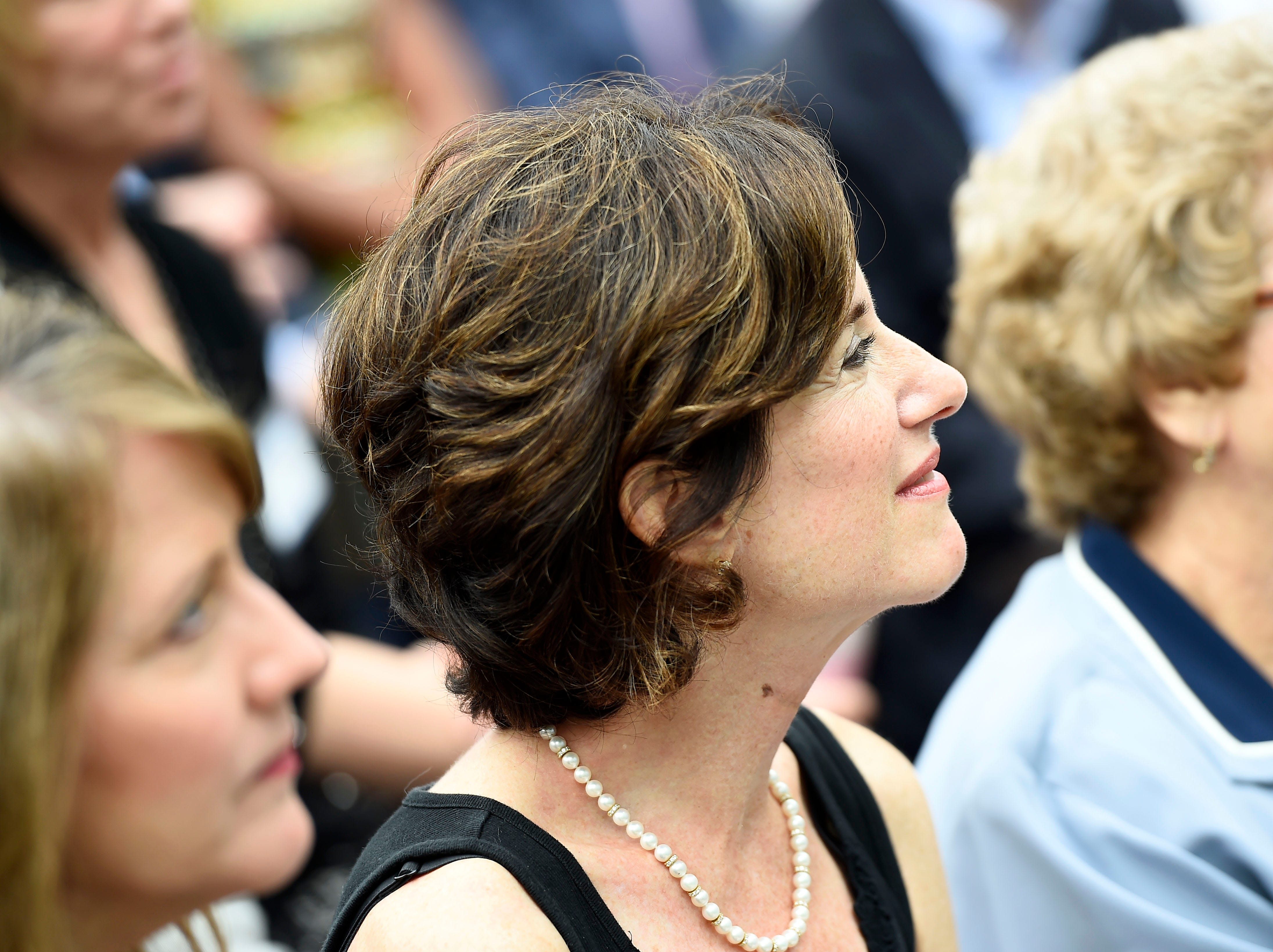 Susan Packard, co-founder and former chief operating officer of HGTV, listens to Kenneth Lowe's remarks as HGTV marks its 20th anniversary outside of the Scripps Networks Interactive headquarters in Knoxville, Tuesday, Sept. 9, 2014.