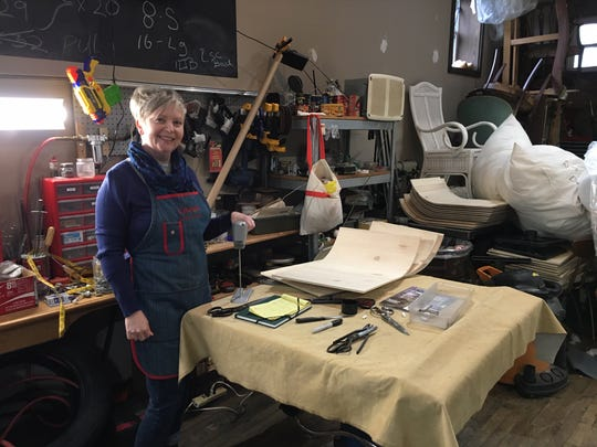 Having grown up in one, Jesica Breitenbach feels very much at home in an upholstery shop.