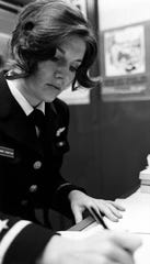 ENS Rosemary Conatser (later Mariner) works at her desk January 9, 1975. She was a pilot associated to Fleet Composite Squadron Two, VC-2.