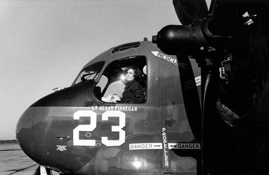 ENS Rosemary Conatser (later Mariner) in the cockpit of a fleet composite Squadron Two, VC-2, S-2 tracker antisubmarine aircraft. She was a pilot of the squadron January 9, 1975.