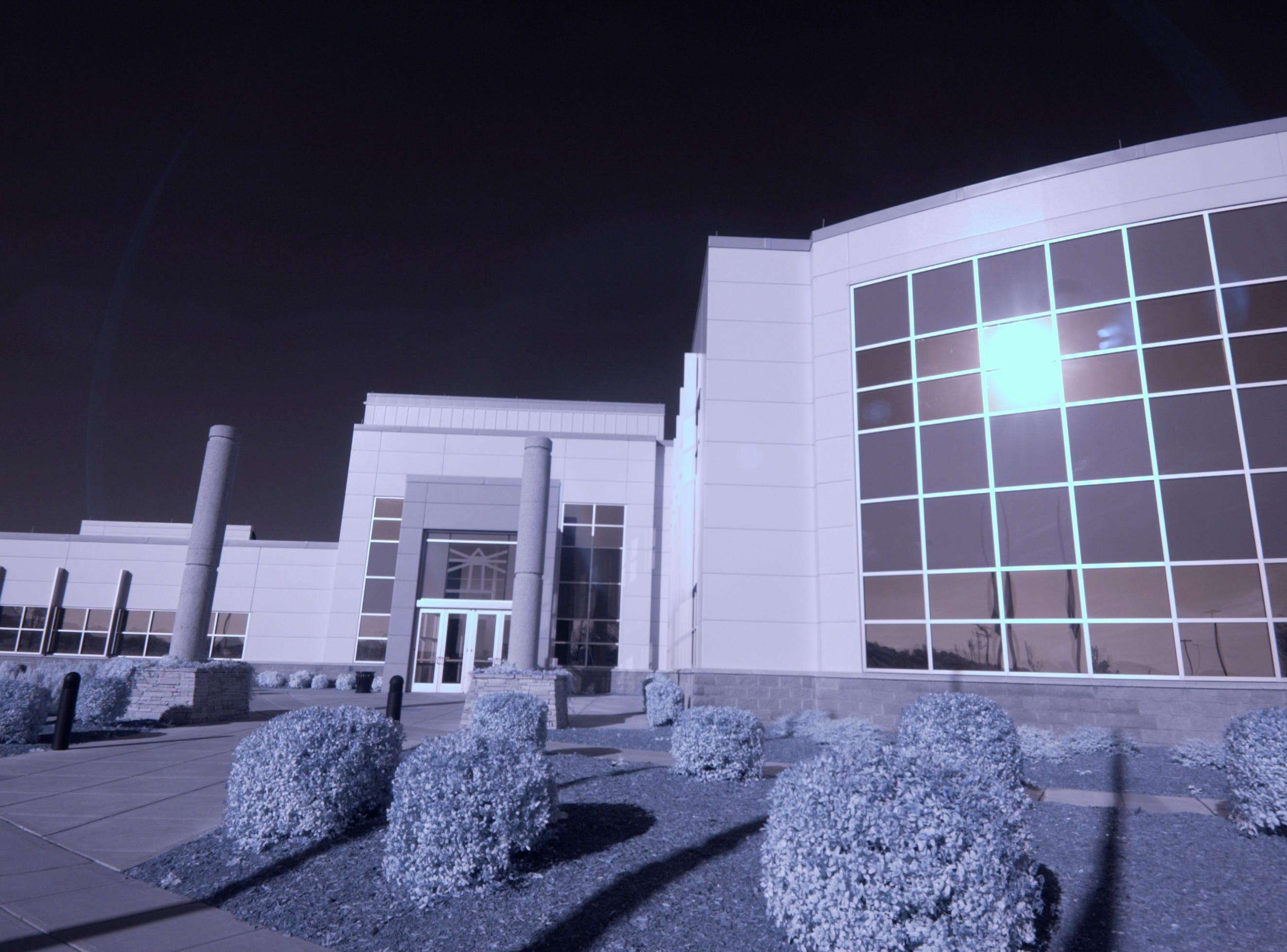 The Knoxville News Sentinel building, seen in B&W infrared. A specially modified digital camera, with the IR cutoff filter removed, allows IR and near-IR light to be recorded. Plants containing chlorophyl reflect a greater amount of IR light, and as a result, are recorded as very light shades of gray.