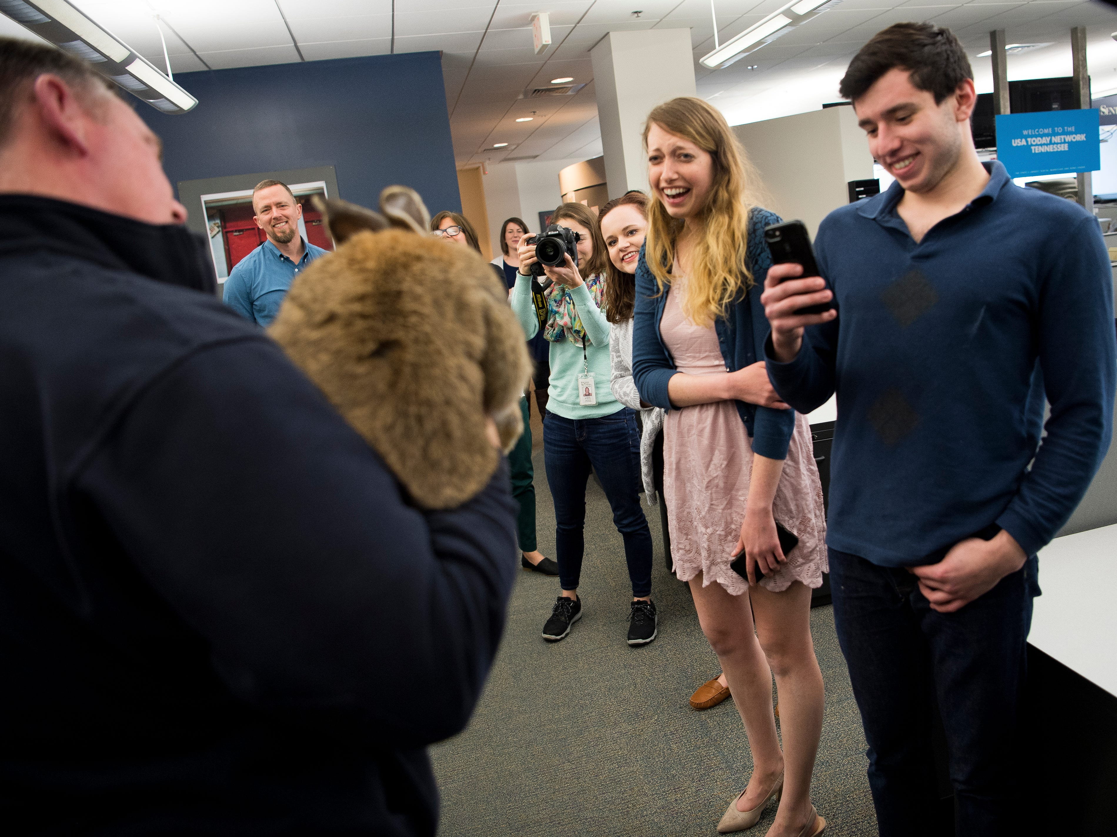 News Sentinel reporters react as the Corcoran family brings their giant pet rabbit Barley to the News Sentinel newsroom on Thursday, January 31, 2019. Barley is a Flemish Giant, considered the largest breed of rabbit in the world.