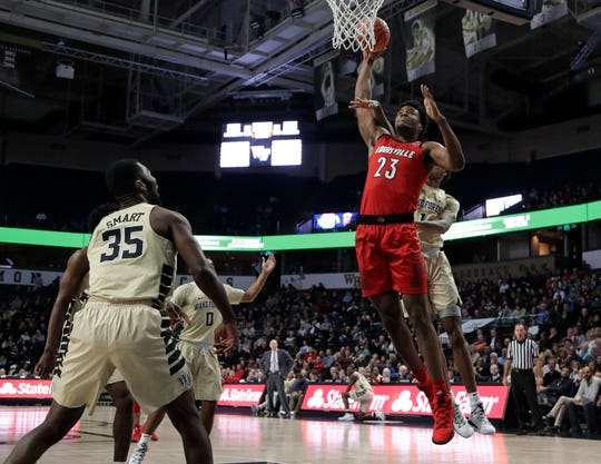 Louisville's Steven Enoch (23) is fouled as he drives to the basket against Wake Forest's Isaiah Mucius (1) during the first half of an NCAA college basketball game in Winston-Salem, N.C., Wednesday, Jan. 30, 2019.