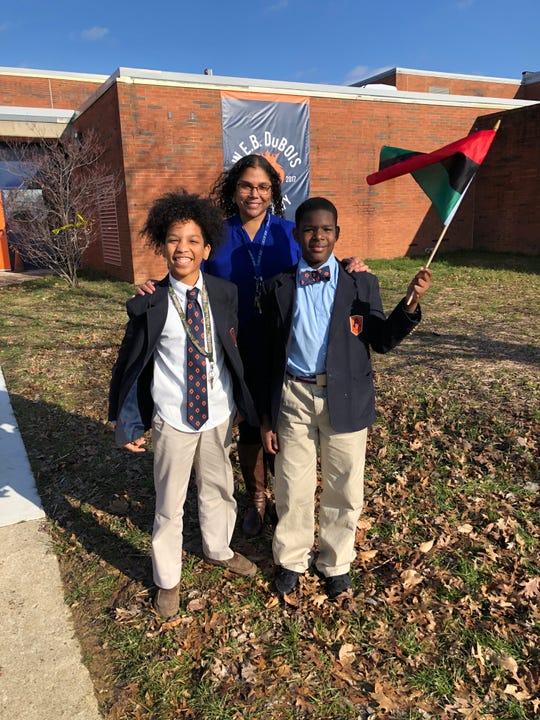 DuBois Academy teacher Jessica Dueñas with Andres Rodriguez, left, and Josiah Burton.