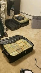 """Authorities found two suitcases containing """"a significant amount of cash"""" from Mark Espinosa's apartment in Middletown, Connecticut."""