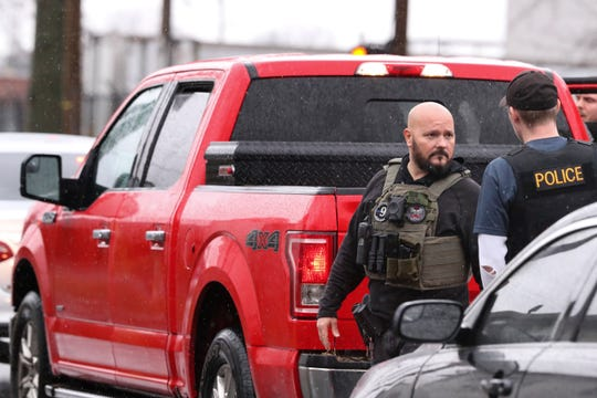 Fugitive Unit detective Mike Woodard, left, spoke with Sgt. Chris McMichael during a traffic stop.  The unit is part of the 9th Mobile Division of the LMPD.Jan. 23, 2019