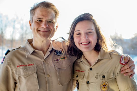 Autumn Eyre, 15, of Laingsburg, right, poses with her father Glenn at their home in Laingsburg on Wednesday, Jan. 30, 2019. Autumn will be among the first older girls allowed into Boy Scouts, being rebranded Scouts BSA on Friday. Glenn, his two brother and his father were Eagle Scouts.