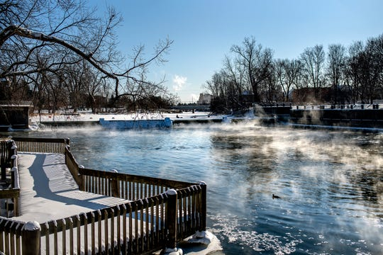 A view on the partially frozen Grand River seen from near the Brenke Fish Ladder on Wednesday, Jan. 29, 2019 in Lansing.