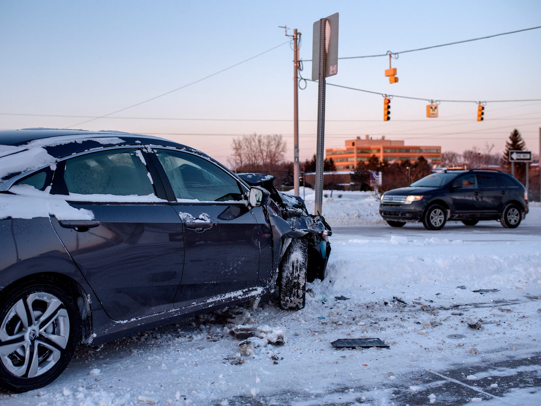 A car involved in two-vehicle accident sits on the inside eastbound lane of Lake Lansing Road near the U.S. 127 exit on Wednesday, Jan. 29, 2019, in East Lansing.