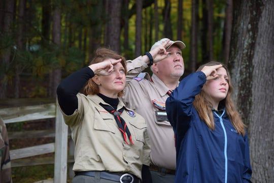 Troop 164 Scoutmaster Marla Ekola with her husband, Tim Ekola, a Boy Scout volunteer, and daughter, Reagan Woods, at an Oct. 6 Water and Woods Fall Camporee at Camp Rotary in Clare. Marla Ekola is leading a new  troop for girls as Boys Scouts of America accepts older girls for the first time Feb. 1.