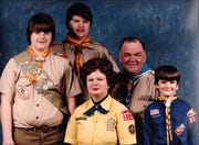 Scouting runs in the family. Glenn Eyre, left, pictured in 1985 with his brother, Scott; mother, Janice, a Cub Scout leader; father, Robert, a Scoutmaster, and brother Mark. The three brothers and their father are Eagle Scouts. Now Eyre will pass it along to his daughter as girls are welcomed into the program.