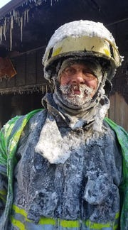 Village of Cameron Fire Chief Mitch Hansen following a fire fought in subzero temperatures Wednesday.